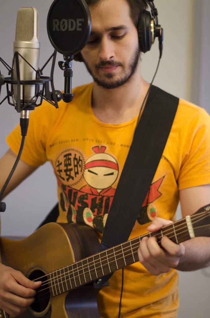 Misha recording vocals & acoustic guitar